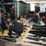 Guatemalan police with the seized weapons