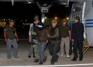 Argentine authorities escort Argentine suspect