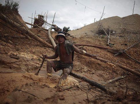 A worker in an illegal gold mine in Peru