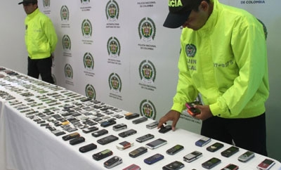 Colombia police with recovered cell phones