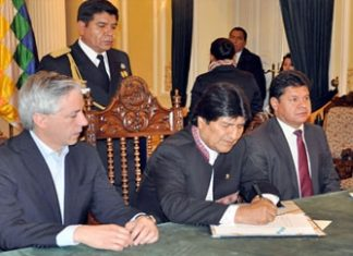 Evo Morales signing the law