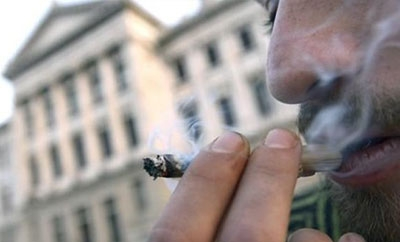 A man smokes marijuana outside Uruguay's congress