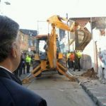"Santos watches as ""ollas"" are demolished"