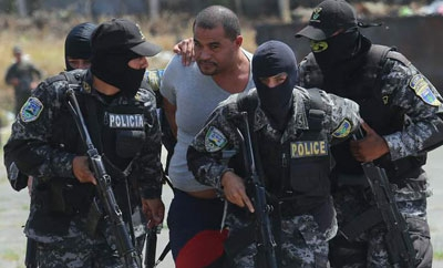 "Carlos ""El Negro"" Lobo escorted by Honduras security forces"