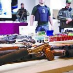 Police display guns, drugs and money seized