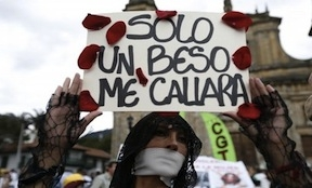 A woman protesting sexual violence in Colombia