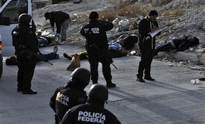 Mexican police examine a murder scene
