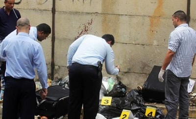 Venezuelan authorities stand by a dismembered body