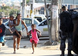 A family flees gang-security force clashes in Rio