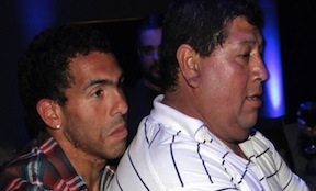 Carlos Tevez with his father