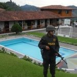 Colombian police during a property seizure