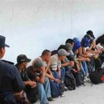 Migrants under guard in Mexico