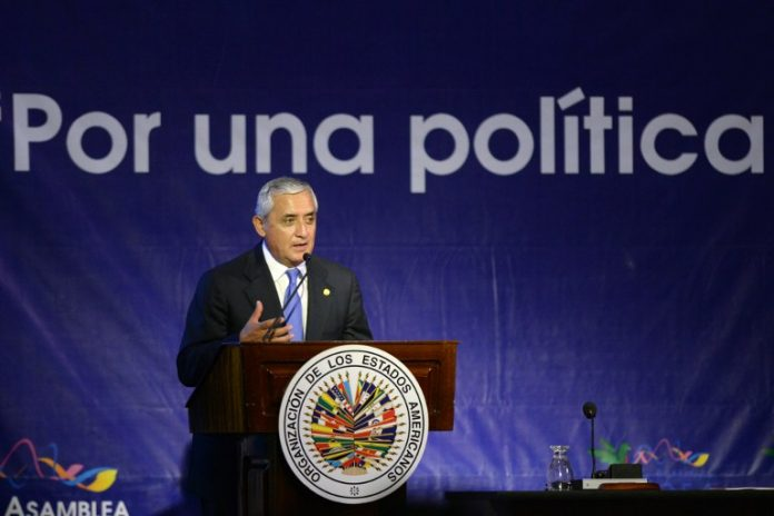 Guatemalan President Otto Perez speaking before the OAS