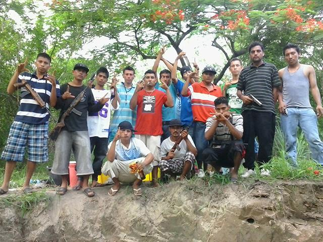 Gang members pose on Chinchontepec