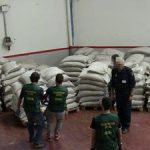 Spanish police inspect seized cargo laced with cocaine