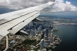 A plane approaching the Miami coastline
