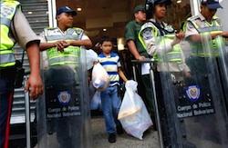 Police outside a Venezuelan supermarket