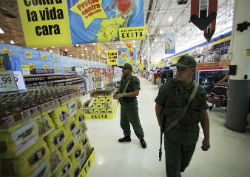 Venezuelan troops patrol a supermarket