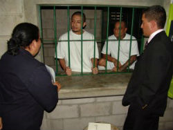 Government officials meet inmates at El Salvador's maximum-security prison