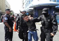 Police in El Salvador apprehend a suspect