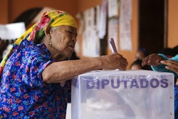 A woman votes in a Mexican election