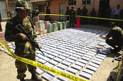 A Bolivian soldier guards a confiscated cocaine shipment
