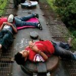 Child migrants on top of a freight train