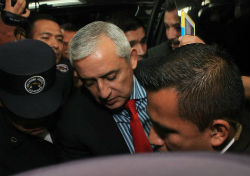 Ex President Perez Molina walking into court