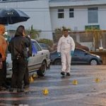 Costa Rica investigators at a murder scene