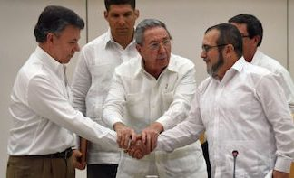 "President Santos (left) and FARC Commander ""Timochenko"" (right)"
