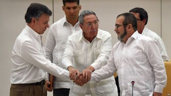 President Santos (left) and FARC Commander