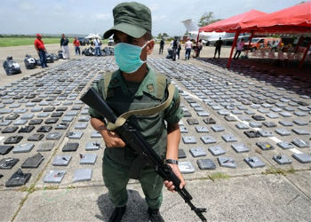 Venezuelan soldier guards a seized drug shipment