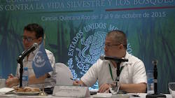 Israel Alvarado (right) speaking at the conference