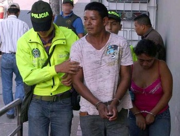 Colombian police arresting low-level drug suspects