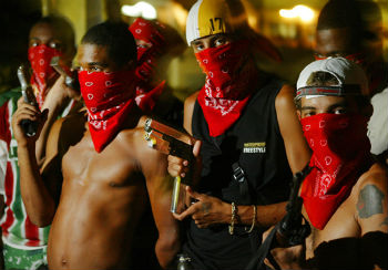 gangs in rio In rio de janeiro's sprawling slums, gang fights and police raids provide a stark contrast to the excitement of the olympic games happening just across the city.