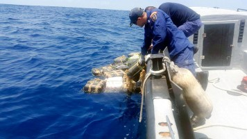 Costa Rican Coast Guard retrieving cocaine from a recent interdiction