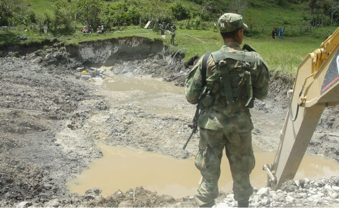 An illegal mining pit in Colombia