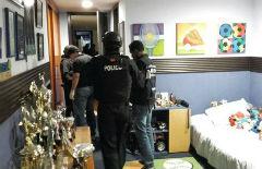 Ecuador police raid alleged illegal gold network