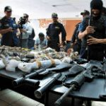 Honduran authorities with seized firearms