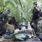Ecuadoran security forces inspect a suspected FARC encampment
