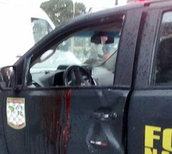 Bloodstained door of the vehicle driven by the National Force officers who were attacked