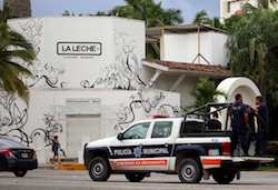 Police outside La Leche restaurant, where the kidnapping took place