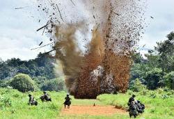 A drug airstrip being blown up in Peru