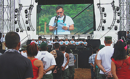 """Timochenko"" on stage at the FARC conference. c/o Ricardo Cruz/Verdad Abierta"