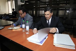 Guatemala's former President of the Central Bank, Edgar Barquín, and his lawyer during court.