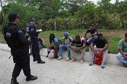 Federal police officers and migrants in Chiapas, Mexico.