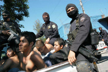 El Salvador police with detained gang members