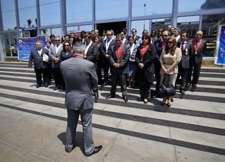 Prosecutors in Lima observing a minute of silence for their murdered colleague.