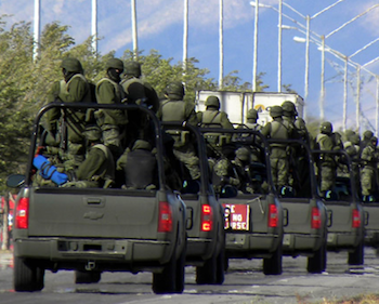 Mexican soldiers in a convoy