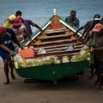 Fisherman bringing their boat ashore on Venezuela's Caribbean coast